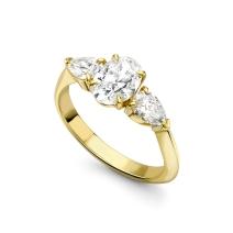 YELLOW GOLD AND DIAMOND THREE-STONE RING
